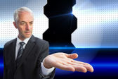 Composite image of concentrated businessman with palm up — Stock Photo
