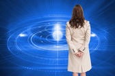 Composite image of rear view of businesswoman — Stock Photo