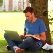 Handsome student studying outside — Stock Video #38902367