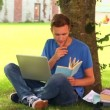 Stock Video: Focused student studying outside