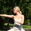 Pretty blonde doing tai chi — Stock Video #38902821