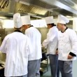 Stock Video: Head chef supervising his team