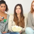 Three friends watching television — Vídeo de stock