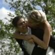 Stock Video: Groom giving his pretty wife piggy back