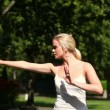 Pretty blonde woman doing tai chi — Stock Video