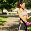 Stock Video: Content sporty womlifting dumbbells