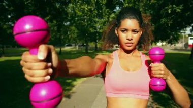 Slender woman using dumbbells — Stok video