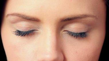 Brunette opening her blue eyes — Stock Video