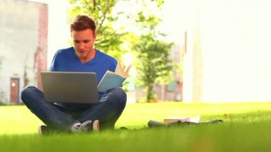 Focused smiling student studying outside — Stock Video