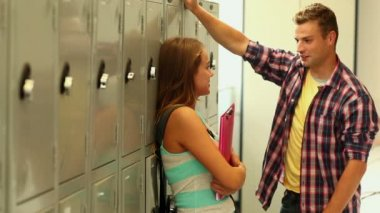 Students flirting in the hallway beside lockers — Stock Video