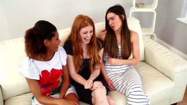 Cheerful fashionable women relaxing on couch — Stock Video