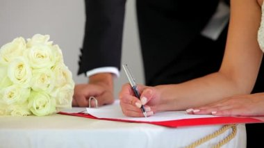 Couple signing their wedding register — Stock Video