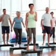 Stock Video: Aerobics class stepping together