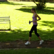 Runner stopping to stretch out in park — Stock Video #39159539