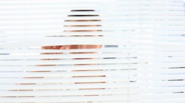 Businesswoman peeking through the blinds — Stock Video