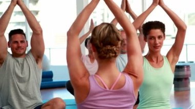Happy yoga class sitting in lotus position together — Stock Video
