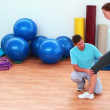 Stock Video: Trainer showing his client how to lunge correctly