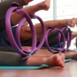 Stock Video: Pilates class using pilates rings