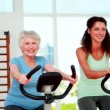 Stock Video: Diverse fitness group doing a spinning class