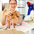 Pretty fashion designer petting her chihuahua — Stock Video #39165175