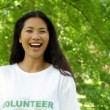 Stock Video: Pretty volunteer smiling at camera