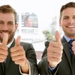 Businessmen giving thumbs up — Stock Video #39165519
