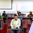 Stock Video: Lecturer speaking to his class