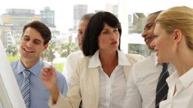 Business people watching woman write something — Stock Video