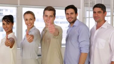 Attractive businesspeople posing showing thumbs up — Stock Video