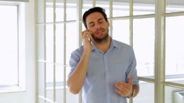 Annoyed young man having a phone call — Stock Video