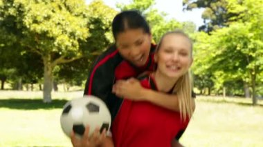 Female football teammates celebrating a win in the park — Stock Video