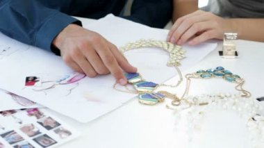Design team looking at costume jewelry and talking — Stock Video