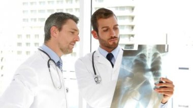 Serious doctors studying an xray — Stock Video