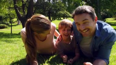 Little boy and parents smiling at camera in the park — Stock Video