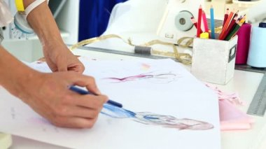Fashion designer sketching a blue dress design — Stock Video