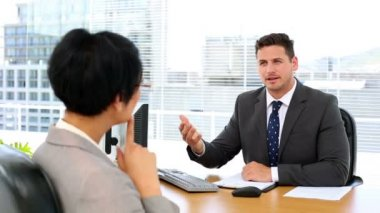 Handsome businessman talking with interviewee — Stock Video