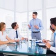 Executives sitting around conference table — Stock Photo #39179605