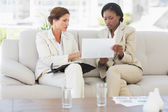 Businesswomen planning together on the sofa — Stock Photo