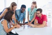 Group of casual artists working on designs — Stock Photo