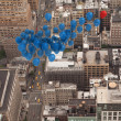 Many colourful balloons above city — Stock Photo #39180017