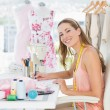 Portrait of a fashion designer working on her designs — Stock Photo #39180313
