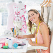 Portrait of a fashion designer working on her designs — Stock Photo