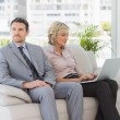 Well dressed man with woman using laptop at home — Stock Photo #39180493