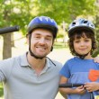 Smiling man with his son riding bicycles — Stock Photo #39180533