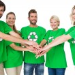 Stock Photo: People in recycling symbol t-shirts with hands together