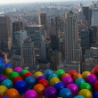 Stock Photo: Many colourful balloons above city