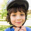 Cute little boy wearing bicycle helmet — Stock Photo