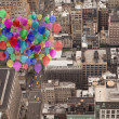 Many colourful balloons above city — Stock Photo #39181471