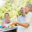 Stock Photo: Extended family dining at outdoor table