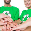 People in recycling symbol t-shirts with hands together — Stock Photo